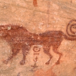 Oued Djaret, Algeria. Close-up of red predator (lion) facing left. Image ID: algdja0040010