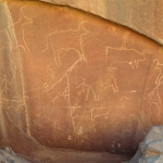 Tibesti Mountains. Outline cows, some with deliberately deformed horns, facing left and right. Two outline giraffe, one decorated with dot-pecking. Three men facing forwards. Image ID: chatim0010010