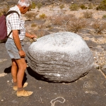 Aar Farm, Namibia. Free-standing boulder, well rubbed on upper surface that also has cupules. When struck, rock chimes. Right next to boulder, geometric design and concentric circles, and foreground, recent curvilinear engravings. Note apparently natural grooves around two sides of boulder. Image ID: namsna0040005