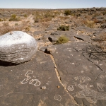 Aar Farm, Namibia. Enlarged view of a boulder on slab. Highly complicated engraving at bottom right involves geometric design with areas in-filled with light pecking, circle with cross in-filled with light pecking and joined by snaky line half circle in-filled with light pecking. Image ID: namsna0040011