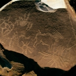 More geometric symbols engraved on a loose rock surrounding an engraved eland, SOASTR0010073