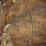 Karkul Tahl, Sudan. On exposed granite cliff, block-pecked engravings of cattle with long twisted horns, dogs and men holding various objects. Image ID: sudkta0030006