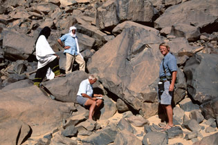 Alec Campbell (sketching a giraffe), David Coulson and Jean Clottes with their Toureg guide, Niger.