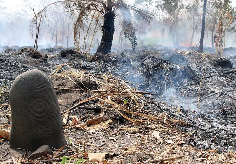 fires threaten cross river monoliths