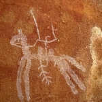 Ennedi Plateau. Warrior mounted on horse. Note bichrome grid below horse. Image ID: chaenp0040015