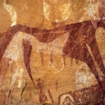 Ennedi plateau. Bichrome cow with udder wearing collar. Image ID: chaenp0050038