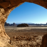 Tassili d' Emi Koussi. Looking out of cave. Note vertical grooves on left wall. Image ID: chatek0060001