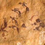 Karkur Tahl. Five maroon people apparently seated. Two dancing women, red shape and white schematic figure. Image ID: egykta0020006