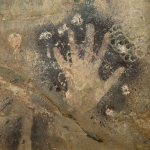 Wadi el Obeyied. Close-up of top handprint. (Grids at right are marks left by wasp nests.) Image ID: egyweo0010030