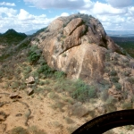 Isiolo. Oblique view of a huge boulder with engravings. Image ID: kenisi0010012