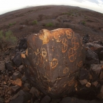 Lokori. 'Fish-eye' photograph of boulder showing engravings on two sides of boulder. Image ID: kenlok0010056