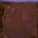 Turkana. On boulder separated from Altar Rock. Crude pecked circle containing cross. Image ID: kentur0050001