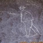 Huns Mts, Namibia. Man firing gun. Image ID: namsnh0030008