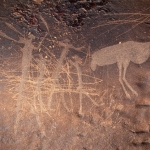Engravings of human figures with an ostrich. Possible hunting scene. Note the damage to the engravings through vandalism, SOANTC0050017