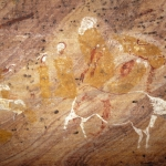 Polychrome paintings of human figures and an animal, possibly a cow. Interestingly, the more prominent human figures are painted in yellow unlike the usual red pigment common in San paintings, SOASWC0020015