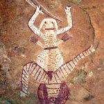 Drakensberg, South Africa. Enigmatic maroon and white highly decorated figure with male and female attributes and swollen stomach, holding bow and two arrows and having two quivers full of arrows on back. Image ID: soadrb0030003