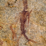 Mashonaland, Zimbabwe. Man with headdress and bent legs strides left with head turned back. Feather(?) in band around left bicep. Image ID: zimmsl0260015